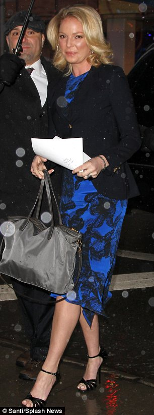 She's electric: Katherine looked lovely in a blue dress with black detailing as she arrived at the New York studio