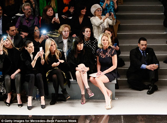Fashionable friends: She was joined on the front row by socialite Tinsley Mortimer (third from left)