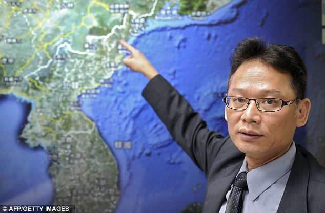 Too close for comfort: Chen Kuo-chang, a senior technical specialist from Taiwan's Seismology Center, showed where the nuclear test is believed to have taken place