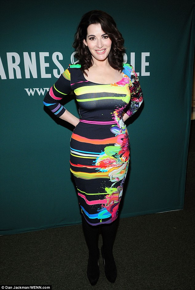 Making the most of her assets: Nigella Lawson shows off her famous curves in a skintight Lycra dress as she promotes her book in New York on Monday