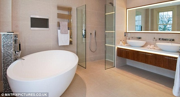 Luxury: Tulisa's £6million home includes a large master bathroom, featuring egg-shaped bath and his 'n' hers sinks