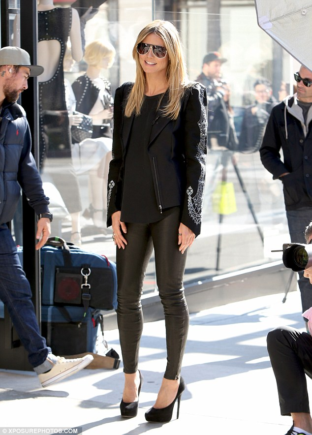 Show stopper: Heidi Klum channeled Catwoman in her slinky black leather trousers and black stilettos on the set of Germany's Next Top Model in Beverly Hills on Tuesday
