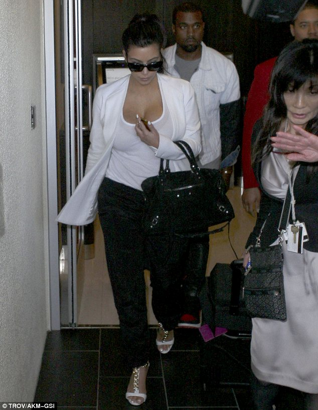 Changing figure: Kim is becoming even more curvaceous since announcing her pregnancy at the end of December