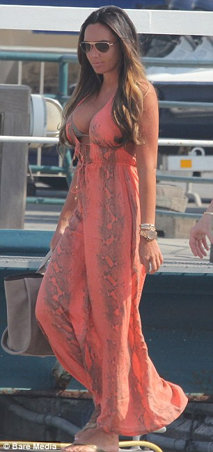 Covering up: Tamara later put an orange snakeskin maxi dress over the bikini as she and her friend headed into town