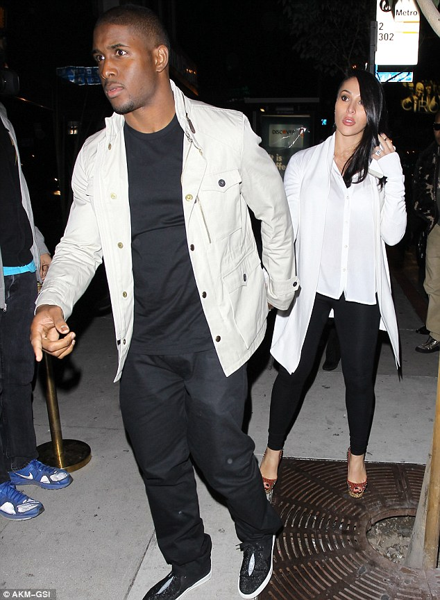 Bumping along: Reggie Bush and his pregnant girlfriend Lilit Avagyan wore matching-coloured outfits for a night out at Bootsy Bellows in West Hollywood on Tuesday night