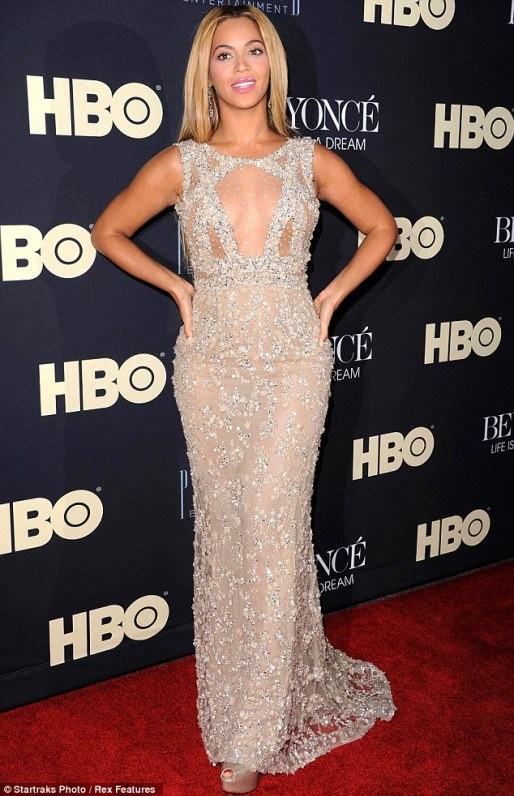Sheer daring: Beyonce displayed plenty of her decolletage in a daring sheer floorlength Elie Saab gown as she stepped onto the red-carpet for the premiere of her documentary Life Is But a Dream on Tuesday night