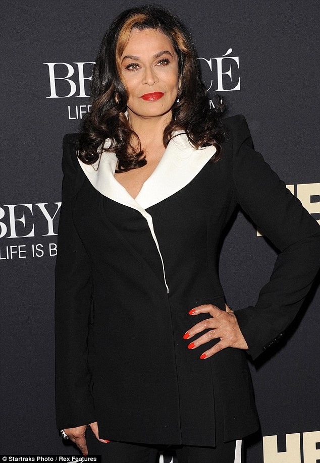 Motherly love: Meanwhile, their mother Tina Knowles looked striking in a black and white pantsuit