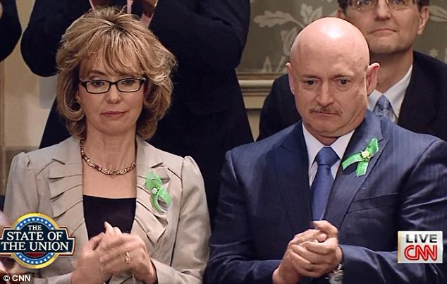 Familiar faces: Former Congresswoman Gabby Giffords and her husband astronaut Mark Kelly wore green ribbons in honor of the victims of the Sandy Hook shooting
