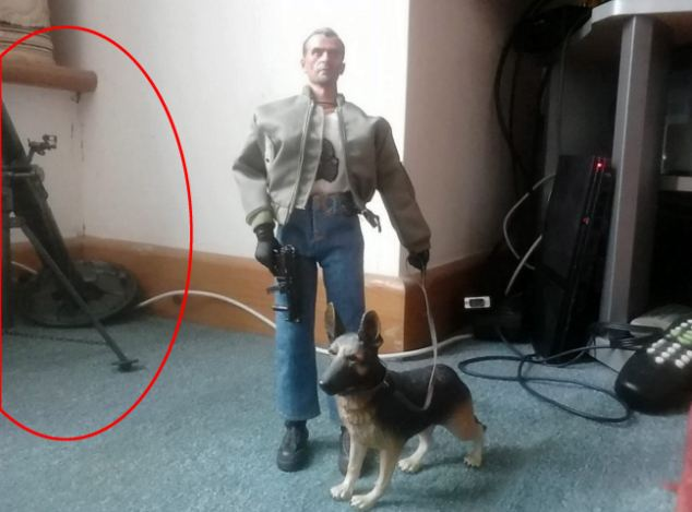 Cause of alarm? The Facebook profile picture of Mr Driscoll showing an action man and his model mortar