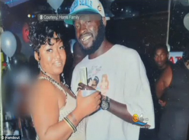 Maurice Harris pictured here with a woman believed to be his wife - has been hailed a hero for his actions on Tuesday evening protecting his family