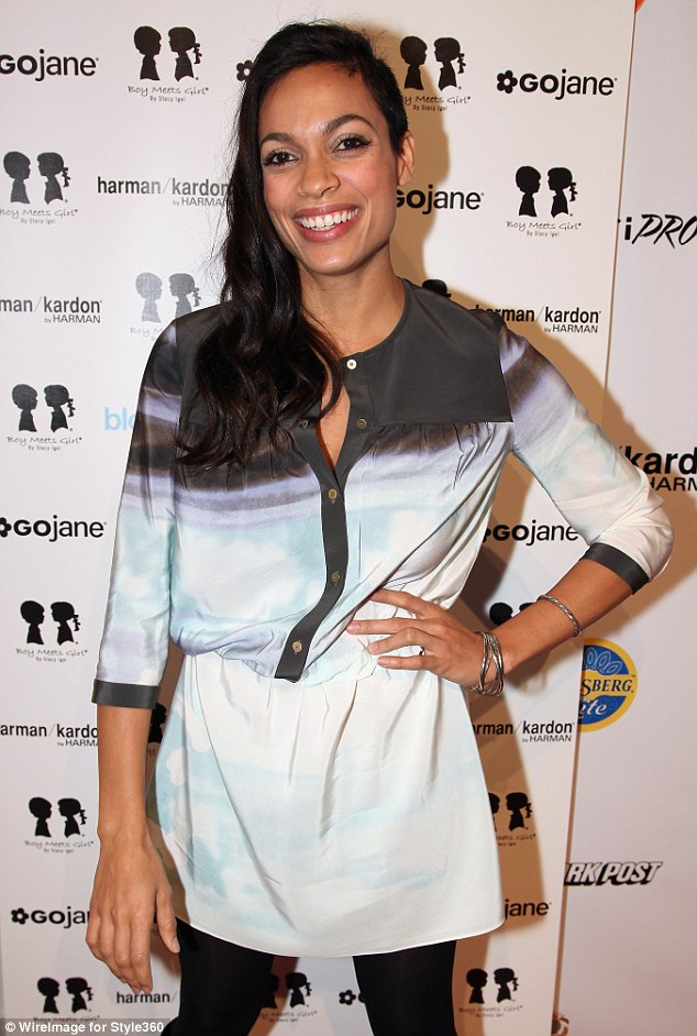 Colgate smile: The actress looked in high spirits as she attended the Stacey Igel fashion show, dressed in a light blue dress and black leather boots