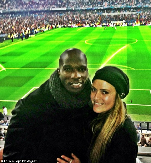 Cooking up a romance: Disgraced NFL player Chad 'Ochocinco' Johnson spent Valentine's Day watching a Madrid football match with chef Lauren Popeil