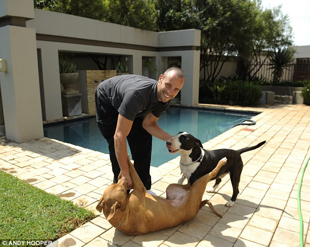 Grand: Mr Pistorius lives in a large farm in Pretoria, which is surrounded by high walls and armed guards