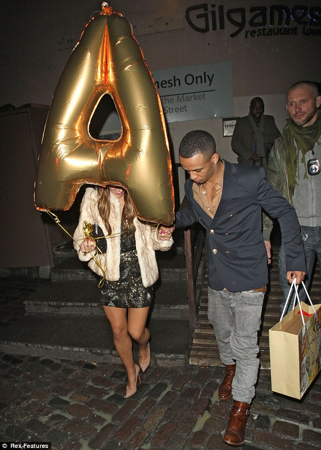Capital A: The JLS singer let his girlfriend Sarah Richards carry his big gold balloon as the couple left the restaurant