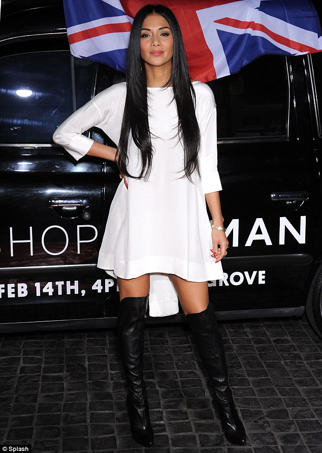 Miaow: Nicole Scherzinger shows off her slender legs in sexy over-the-knee boots as she attends the Topshop store launch in Los Angeles on Wednesday night