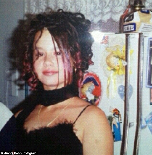 Bed head: Amber Rose tweeted this picture of herself with outrageous curls in a flashback salute to 1999