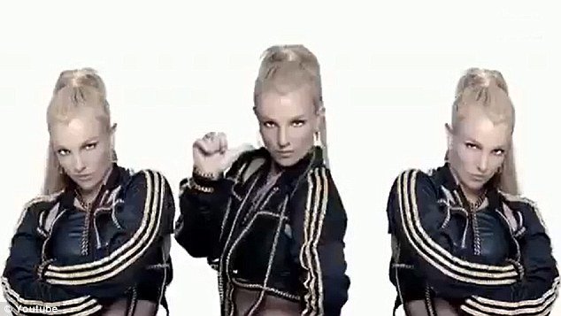What a get-up: Britney dons an Adidas black and gold-braid track suit that features a short cropped top with cutaways in back