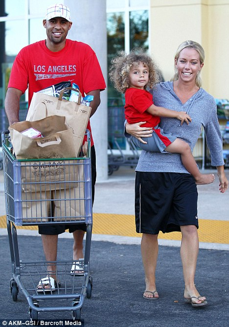 Low-key: Kendra Wilkinson steps out for a grocery run with her husband, Hank Baskett, and their then two-year-old son, Hank Jr, in Los Angeles on June 24, 2012