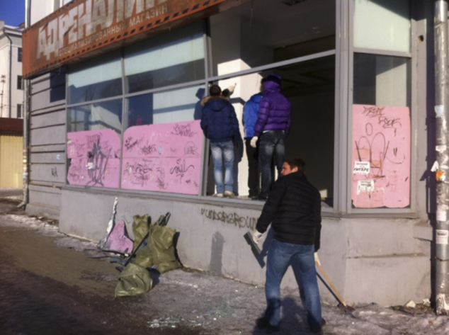 Aftermath: People look at damage to a shop following the meteor shower