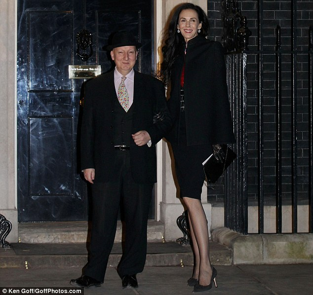 Towering: Stephen Jones and L'Wren Scott posed outside the famous door