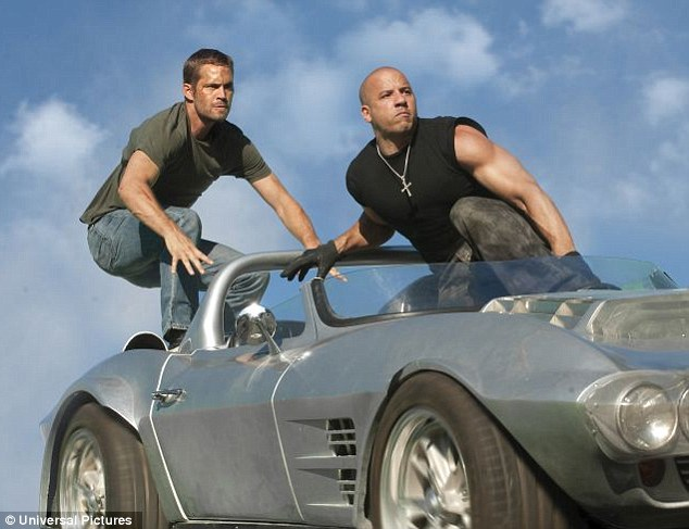 Day job: Vin Diesel (right) is best known for his roles in the Fast and Furious film series