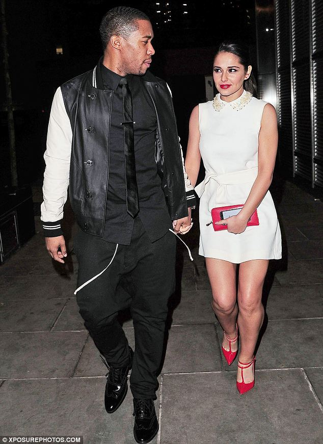 Looking cool: Tre wore an all black smart outfit which he teamed with a cream and white baseball style jacket