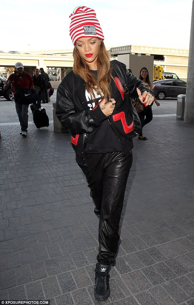 His and hers: Rihanna was spotted wearing Chris Brown's coat at an airport in Los Angeles on Friday