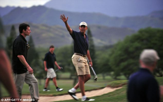 President Obama is spending the holiday weekend in Florida playing golf (seen here during a trip to Hawaii in 2009)