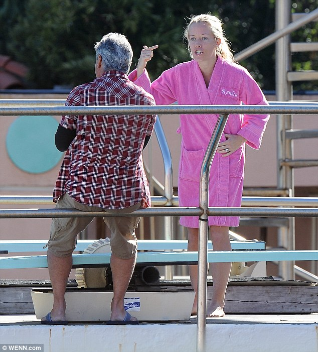 Losing the plot: Kendra Wilkinson loses her cool as she trains for Splash with Greg Louganis on Friday in Los Angeles, California