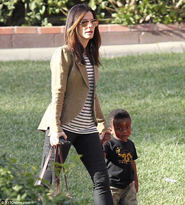 Super kid: Sandra Bullock spent the afternoon in Beverly Hills on Friday with her son Louis, who was painted up as The Flash