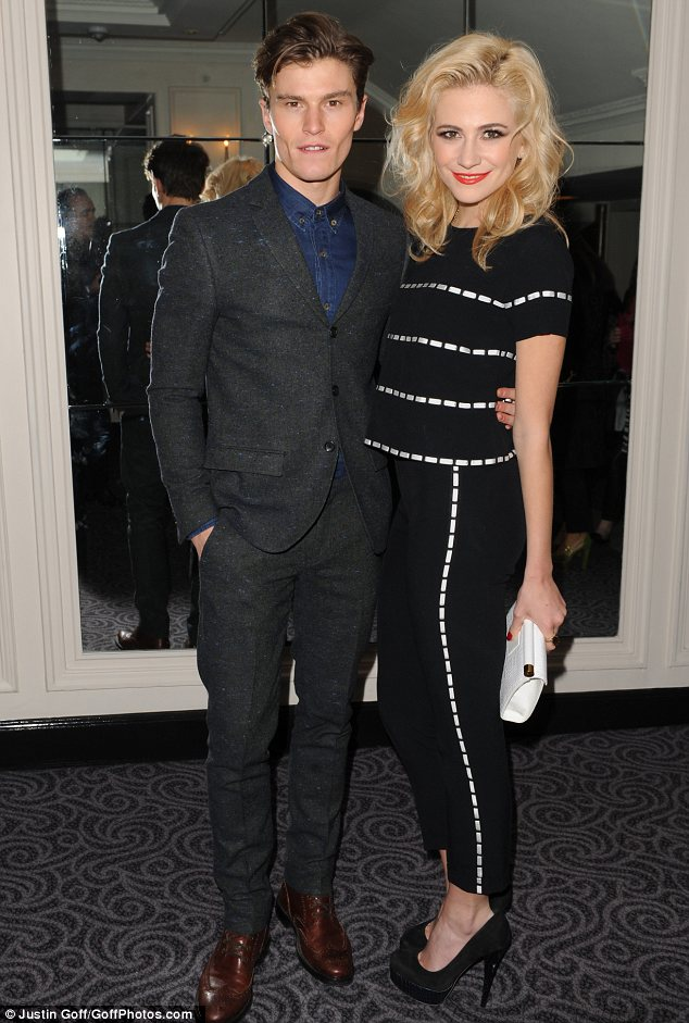 Striped delight: Pixie swapped her LBD for a monochrome suit