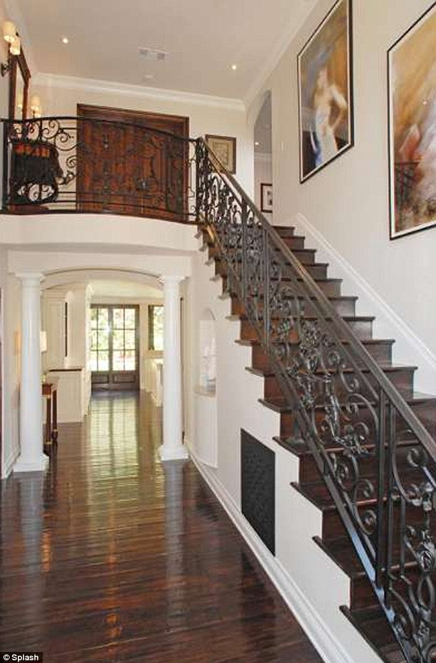 Lovely: The wrought iron staircase invites the gaze with its beautiful detail