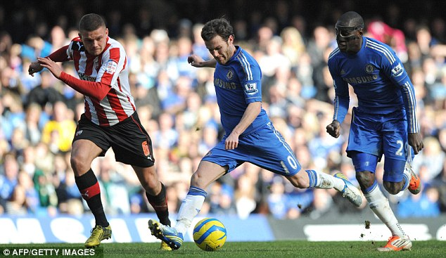 Pulling the trigger: Juan Mata shoots to score Chelsea's opening goal against Brentford