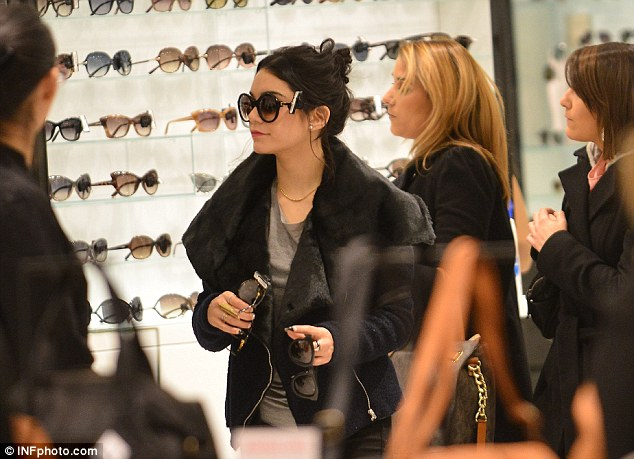 Can travel, will shop: Vanessa had her hands full in the sunglasses section