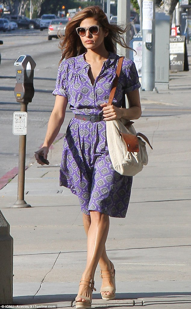 Working it: Eva Mendes went for a shopping trip in Los Angeles Sunday wearing another vintage inspired dress