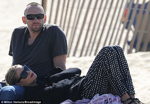 Day in the sun: Heidi Klum and boyfriend Martin Kristen relaxed at the beach in Santa Monica, California on Sunday