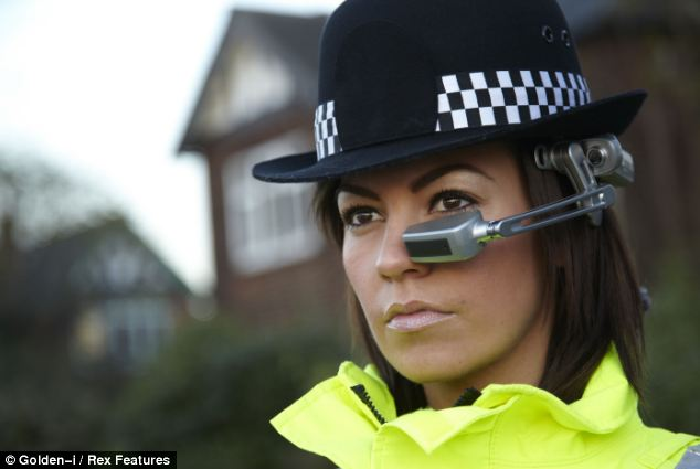 A Female police officer wearing the Golden-i headset computer, which could give officers information and even let them see round walls using infrared sensors