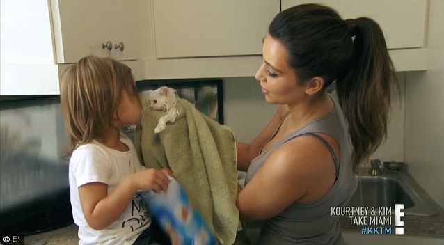 Auntie's little helper: Mason lent Kim a hand in trying some new shampoo to help with the allergies