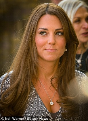 Bejewelled: Tanned Kate accessorised her outfit with a diamond pendant and pearl earrings