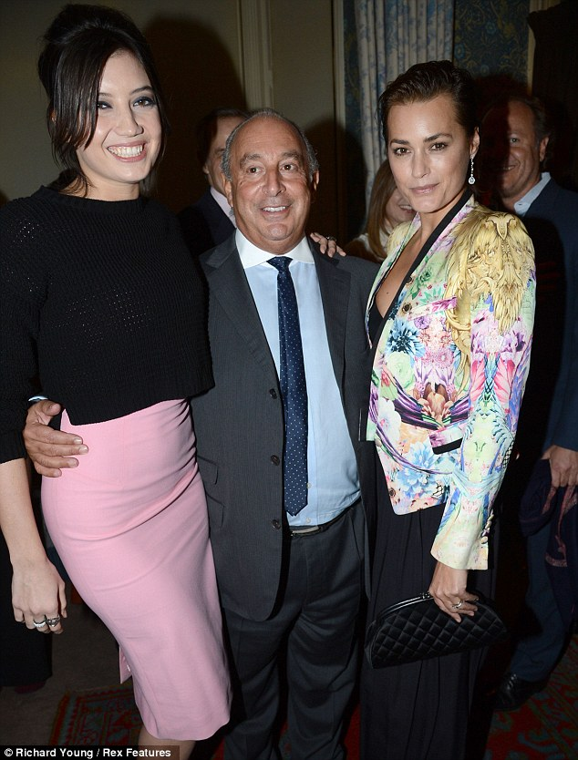 Someone's happy: Philip looked like the cat who got the cream as he posed with Daisy Lowe and Yasmin Le Bon either side of him