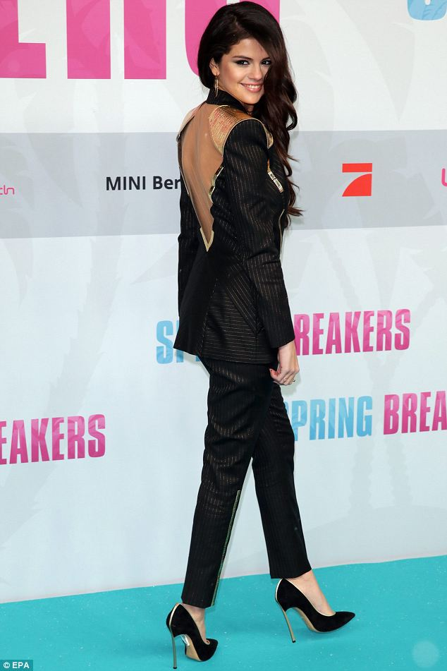 Daring: As the actress turned around she revealed the interesting back detail of her suit