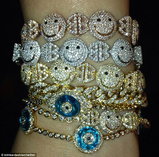 Spoilt: Kim had earlier tweeted this picture of an arm stacked with sparkly braceletswith the message 'I'm feeling happy & protected all thanks to Lorraine Schwartz'