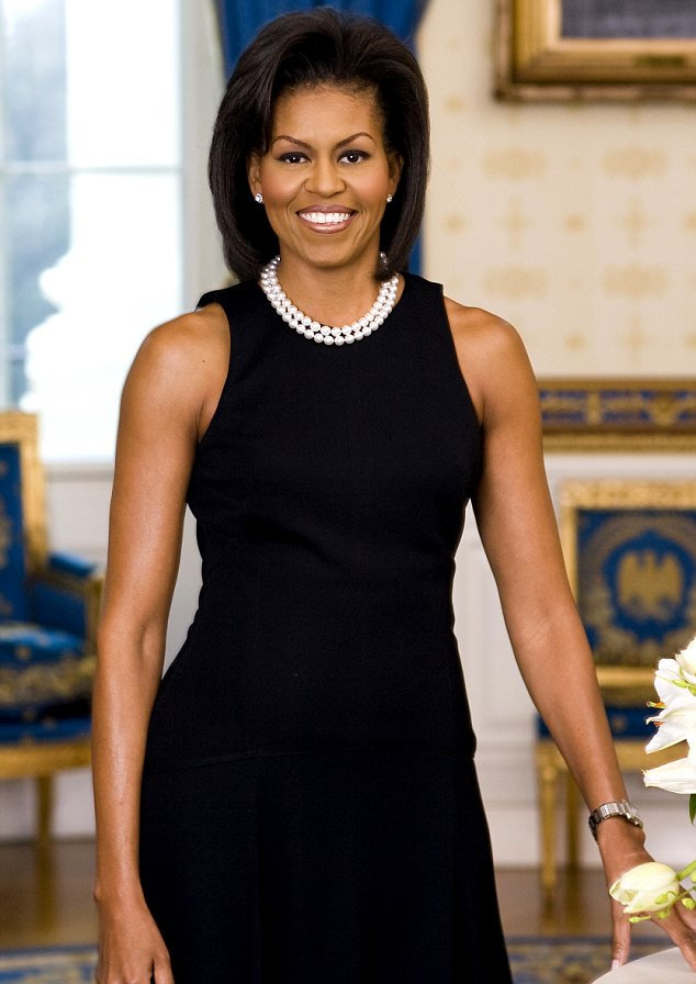 Classic look: The last official portrait, released in February 2009, shows Mrs Obama in a sleeveless Michael Kors dress baring those famously toned upper arms