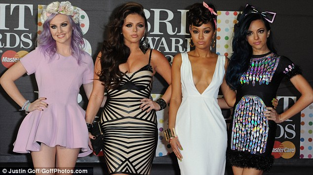Perfecting their poses: Former X Factor contestants Little Mix have come a long way since their days on the television talent contest and looked wore more glamorous outfits than their usual casual attire at this year's Brit Awards