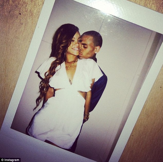 Her birthday wish came true: Chris Brown nuzzles into Rihanna's neck in a romantic snap the singer shared on her Instagram account on Wednesday