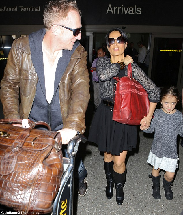 Matching! Salma Hayek and daughter Valentina both opt for skirts and boots as they head out of LAX