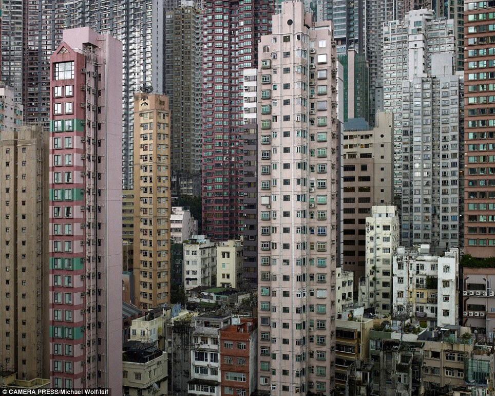 Hong Kongs human battery hens Claustrophobic images show how slum families squeeze their lives into the tiniest apartments  Daily Mail Online