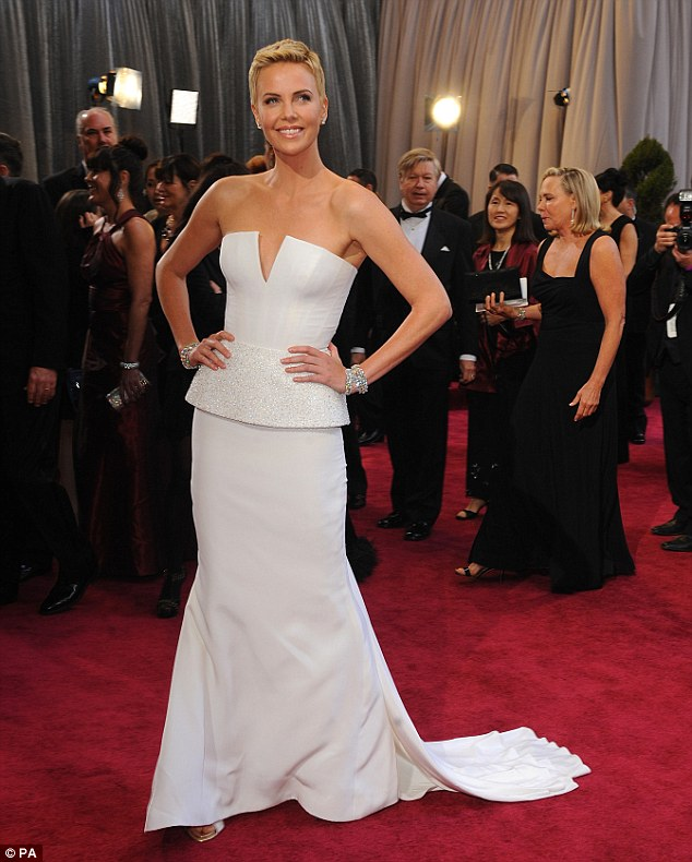 'The most freeing thing': Charlize Theron said cutting her hair was 'freeing' during an interview on the Oscars red carpet on Sunday
