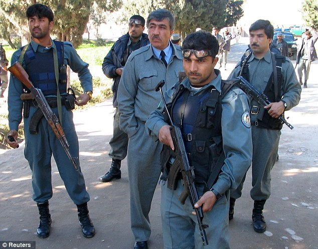 Afghan police in Jalabad, 2007. Some officers are believed to be selling off arms, petrol and even scrap metal from security walls