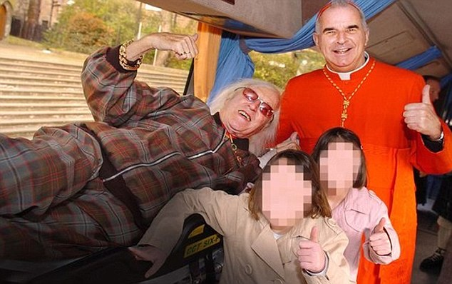 Friends: Jimmy Savile, left, and Cardinal Keith O'Brien were pictured together in Edinburgh in 2007 as the pair unveiled a £375,000 vehicle for the disabled